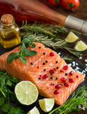 Salmon with vegetables, olive oil and herbs Royalty Free Stock Image