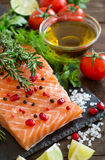 Salmon with vegetables, olive oil and herbs Stock Photos
