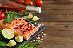 Salmon with vegetables, olive oil and herbs Royalty Free Stock Photography