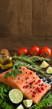 Salmon with vegetables, olive oil and herbs Stock Photography