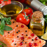 Salmon with vegetables, olive oil and herbs Stock Images