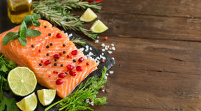 Salmon with vegetables, olive oil and herbs Royalty Free Stock Photo