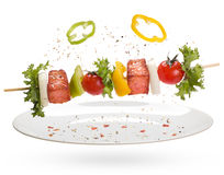 Salmon with vegetables on a skewer Royalty Free Stock Images