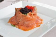 Salmon volcano salad with rocket and caviar Royalty Free Stock Photo