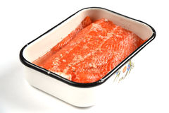 Salmon on the white background. Salmon in the dish on the white background Stock Photo