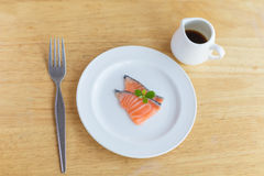 Salmon in white dish and fork. On wooden Stock Photography