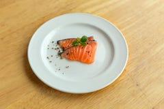 Salmon in white dish. On wooden Stock Photos