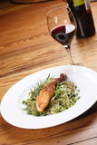 Salmon with wild garlic pasta. And redwine Stock Images