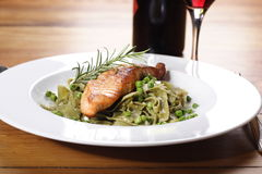 Salmon with wild garlic pasta Royalty Free Stock Photos