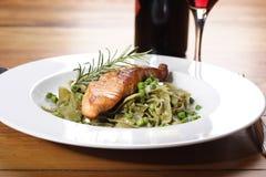 Salmon with wild garlic pasta royalty free stock photos