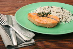 Salmon with wild rice on a plate Royalty Free Stock Photos