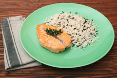 Salmon with wild rice on a plate Stock Photo