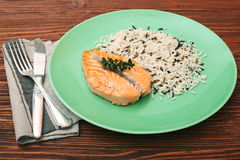 Salmon with wild rice on a plate Stock Photos