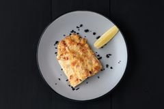 Salmon With Lemon On A Black Wooden Background Royalty Free Stock Photos