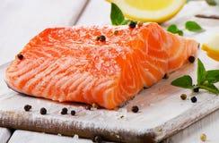 Salmon on a wooden board Stock Photos