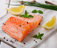Salmon on a wooden board Royalty Free Stock Image