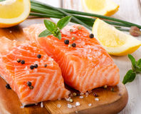 Salmon on a wooden board Royalty Free Stock Photo