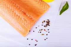 Salmon on a wooden board . Selective focus. Fish and seafood: Salmon, skin side down Stock Photos