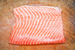 Salmon on wooden chopping board Royalty Free Stock Photos