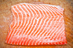 Salmon on wooden chopping board Royalty Free Stock Photo