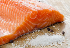 Salmon on a wooden plate Royalty Free Stock Photo