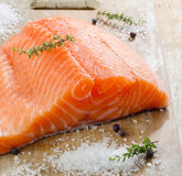 Salmon on a wooden plate Stock Images
