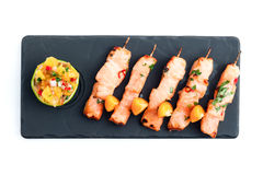 Salmon yakitori. Skewered salmon (yakitori) with sauce isolated on white Royalty Free Stock Image