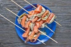 Salmone affumicato e carciofo arrostito Fotografie Stock