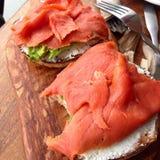 Salmones en el pan para el desayuno Imágenes de archivo libres de regalías