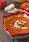 Salmorejo (tomato cream) on wooden background Stock Photo
