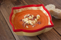 Salmorejo (tomato cream) on wooden background Stock Images