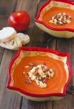 Salmorejo (tomato cream) on wooden background Royalty Free Stock Image