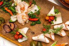 Salo with cucumbers and pepper on a wooden board. Traditional Ukrainian food Royalty Free Stock Photo
