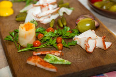 Salo with cucumbers and pepper on a wooden board. Traditional Ukrainian food Stock Photography