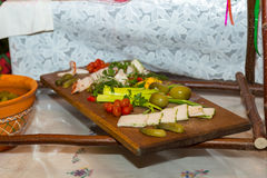 Salo with cucumbers and pepper on a wooden board. Traditional Ukrainian food Stock Image