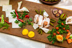 Salo with cucumbers and pepper on a wooden board. Traditional Ukrainian food Stock Images