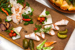 Salo with cucumbers and pepper on a wooden board. Traditional Ukrainian food Stock Photos