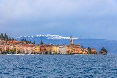 SALO, ITALY - FEBRUARY 24, 2019: Panoramic view of the city Salo Salò and the embankment on Lake Garda. In the background are royalty free stock photos