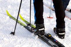 Salomon Ski Boots And Fischer Skis Arkivfoton