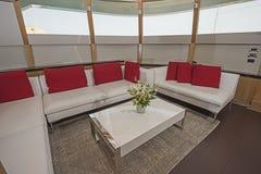 Salon area on large luxury motor yacht Stock Photos