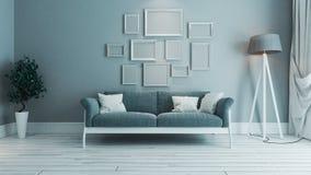 Salon bleu de couleur avec l'idée de conception intérieure de cadre de photo Photos stock