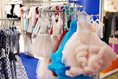 Salon of children and teenagers dresses. In shop royalty free stock image
