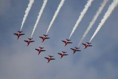 Salon de l'aéronautique rouge de flèches de Royal Air Force Photographie stock libre de droits