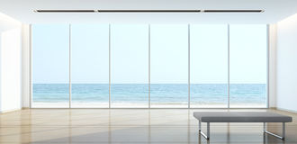 Salon de vue de mer dans la maison moderne Photographie stock libre de droits