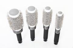 Salon runde Hairbrushes getrennt Stockbilder
