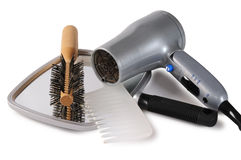 Salon set. Beauty care set hairdryer, brush,mirror and comb Royalty Free Stock Photo