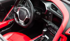 Salon sports car. Steering wheel, dashboard. Leather, red stitching. stock photo