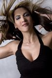 Salon style. Healthy beautiful long hair in motion created by wind, fashion look Stock Image