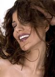 Salon style. Healthy beautiful long hair in motion created by wind, fashion look Stock Photos