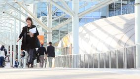 Salone del Mobile 2014. People walk to the entrance of Salone del Mobile, international trade show of design and furniture in Milano, Italy stock video footage